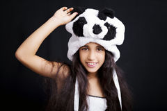 Portrait of a adorable girl in panda hat Royalty Free Stock Photos