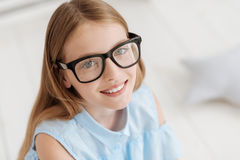 Portrait of adorable girl wearing glasses smiling Stock Image