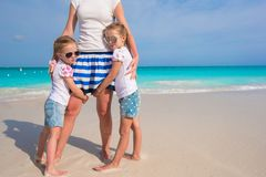 Portrait of adorable girls near momther at exotic beach on vacation Stock Images