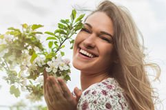 Portrait of adorable happy girl near the blooming apple tree Royalty Free Stock Photos