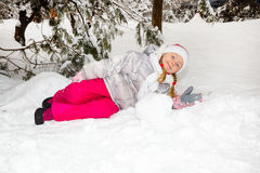 Portrait of adorable happy little girl grinning happily at the camera on a sunny winter`s day Royalty Free Stock Images