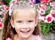 Portrait of adorable happy  little girl in the park Royalty Free Stock Images