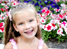 Portrait of adorable happy  little girl in the park Royalty Free Stock Photo