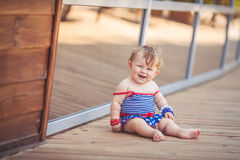 Portrait of adorable infant smiling girl in summer outdoor Royalty Free Stock Photos