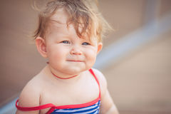 Portrait of adorable infant smiling girl in summer outdoor Royalty Free Stock Images