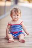 Portrait of adorable infant smiling girl in summer outdoor Royalty Free Stock Photo