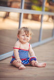 Portrait of adorable infant smiling girl in summer outdoor Stock Photos