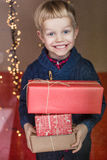 Portrait of adorable kid with gift boxes. Christmas. Birthday Royalty Free Stock Photography