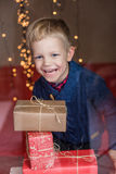 Portrait of adorable kid with gift boxes. Christmas. Birthday Royalty Free Stock Photo