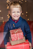 Portrait of adorable kid with gift boxes. Christmas. Birthday Royalty Free Stock Photos