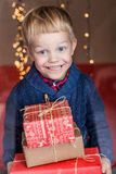 Portrait of adorable kid with gift boxes. Christmas. Birthday Royalty Free Stock Images