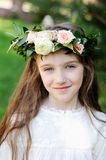 Portrait of adorable kid girl with floral wreath Royalty Free Stock Photography