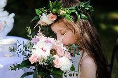 Portrait of adorable kid girl with floral wreath Stock Images