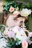 Portrait of adorable kid girl with floral wreath Stock Photos