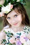 Portrait of adorable kid girl with floral wreath Royalty Free Stock Photos