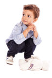 Portrait of an adorable little boy looking away. On white bakground Stock Images