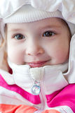 Portrait of adorable little girl. Portrait of a charming little girl in a winter cap royalty free stock photo