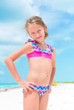 Portrait of adorable little girl at beach during summer vacation. Cute little girl at beach during summer vacation Royalty Free Stock Photos