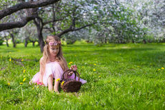 Portrait of adorable little girl in blossoming Royalty Free Stock Images