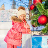 Portrait of adorable little girl at Christmas tree Royalty Free Stock Photo