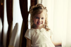 Portrait of adorable little girl with curls Stock Photography