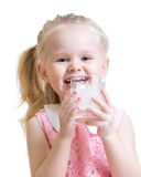 Portrait of adorable little girl drinking glass of Stock Photos