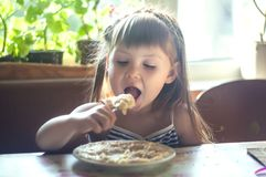 Portrait of adorable little girl having lunch Royalty Free Stock Image