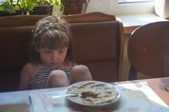 Portrait of adorable little girl having lunch Stock Photos