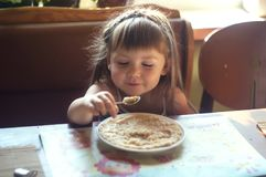 Portrait of adorable little girl having lunch Royalty Free Stock Photo