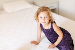 Portrait of adorable little girl at hotel room Royalty Free Stock Images