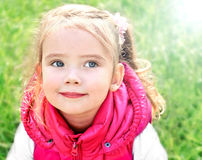 Portrait of adorable little girl on the meadow Royalty Free Stock Image