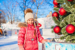 Portrait of adorable little girl near Christmas Stock Image