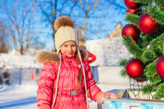 Portrait of adorable little girl near Christmas Stock Images