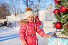 Portrait of adorable little girl near Christmas Royalty Free Stock Images