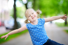 Portrait of adorable little girl outdoors on sunny summer day Stock Image