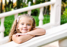 Portrait of adorable little girl in the park Royalty Free Stock Photo