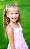 Portrait of adorable little girl in the park Stock Photography