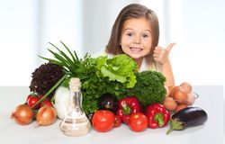 Portrait of adorable little girl preparing healthy royalty free stock photography