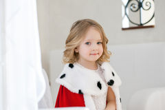 Portrait of adorable little girl in royal mantle Stock Photography