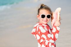 Little girl with a seashell Royalty Free Stock Photo