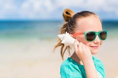 Little girl with a seashell Royalty Free Stock Photography