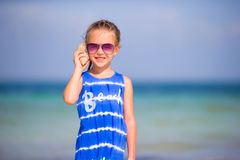 Portrait of adorable little girl with a seashell Royalty Free Stock Photos