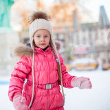 Portrait of adorable little girl on skating rink Stock Photography
