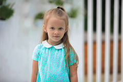 Portrait of adorable little girl on a warm summer Stock Image