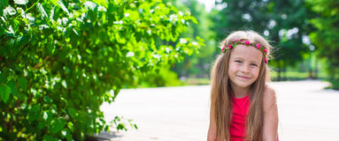 Portrait of adorable little girl on a warm summer Stock Photo