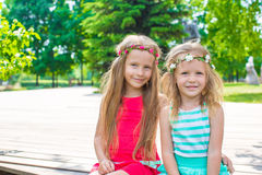 Portrait of adorable little girls on warm summer Royalty Free Stock Images