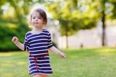 Portrait of adorable little kid girl in summer park Royalty Free Stock Photo
