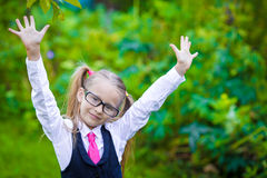Portrait of adorable little school girl in glasses Stock Image