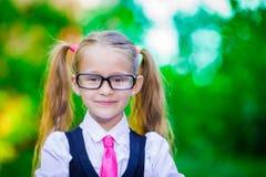 Portrait of adorable little school girl in glasses Stock Image