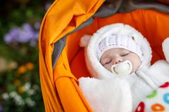 Portrait of adorable newborn baby in warm winter clothes Stock Photo